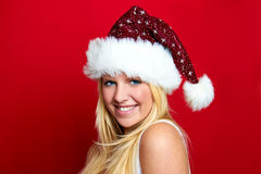 La muchacha en la Navidad está sonriendo Imágenes de archivo libres de regalías