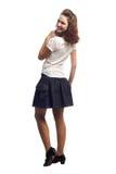 La muchacha en la situación de la blusa y de la falda aisló blanco Fotografía de archivo