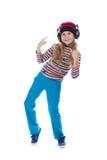 La muchacha en los auriculares que bailan a la música Imágenes de archivo libres de regalías