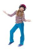 La muchacha en los auriculares que bailan a la música Fotografía de archivo libre de regalías