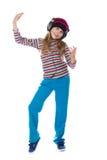 La muchacha en los auriculares que bailan a la música Foto de archivo