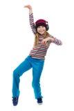La muchacha en los auriculares que bailan a la música Imagenes de archivo