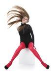 La muchacha en medias rojas Fotos de archivo libres de regalías