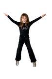 La muchacha en negro en un salto Foto de archivo libre de regalías
