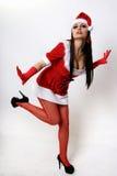 La muchacha en ropa de la Navidad. Fotografía de archivo