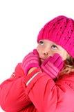 La muchacha en ropa del invierno siente el aislante frío en blanco Imagen de archivo libre de regalías