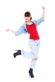 La muchacha en tejanos está bailando imagen de archivo