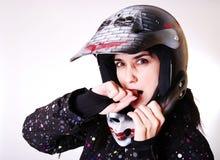 La muchacha en un casco. Fotos de archivo libres de regalías