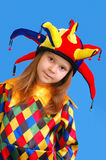 La muchacha en un juego del payaso Imagen de archivo libre de regalías