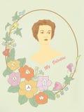 la muchacha en un marco con las flores Imagen de archivo
