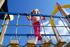 La muchacha en un patio de los niños Fotos de archivo libres de regalías