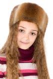 La muchacha en un piel-casquillo del invierno Fotos de archivo libres de regalías