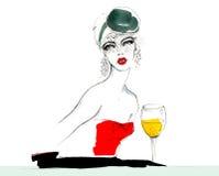 La muchacha en un sombrero con un velo y un vestido rojo Fotografía de archivo