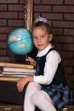 La muchacha en un uniforme escolar Imágenes de archivo libres de regalías