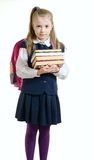 La muchacha en un uniforme escolar con los libros Foto de archivo