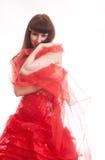 La muchacha en una alineada de bola roja Imágenes de archivo libres de regalías