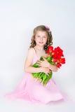 La muchacha en una alineada rosada Fotos de archivo