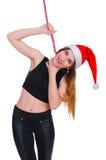 La muchacha en una dieta del ` s del Año Nuevo Muchacha con la cinta métrica alrededor de su cuello dieta del Posts-día de fiesta Fotos de archivo libres de regalías