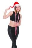 La muchacha en una dieta del ` s del Año Nuevo Muchacha con la cinta métrica alrededor de su cuello dieta del Posts-día de fiesta Fotografía de archivo