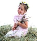 La muchacha en una guirnalda de las flores Fotografía de archivo