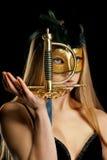 La muchacha en una máscara Imagen de archivo libre de regalías