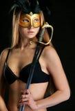 La muchacha en una máscara Imagen de archivo