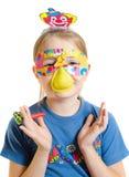 La muchacha en una máscara en cumpleaños Fotos de archivo libres de regalías