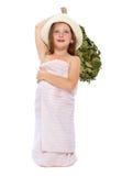 La muchacha en una toalla de baño y un casquillo Foto de archivo libre de regalías