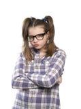 La muchacha enojada en una camisa de tela escocesa Fotografía de archivo