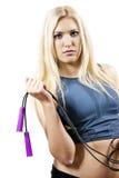 La muchacha es atleta con una cuerda Foto de archivo libre de regalías