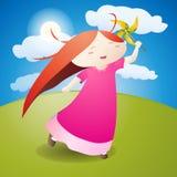La muchacha es molinillo de viento del juego Imagen de archivo libre de regalías