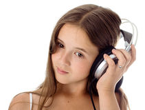 La muchacha escucha la música Imagen de archivo libre de regalías