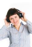 La muchacha escucha la música Foto de archivo libre de regalías