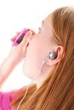 La muchacha escucha música Fotografía de archivo libre de regalías