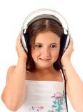 La muchacha escucha una música Fotos de archivo libres de regalías