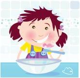 La muchacha está aplicando los dientes con brocha Imagen de archivo libre de regalías