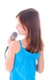 La muchacha está cantando Fotografía de archivo libre de regalías