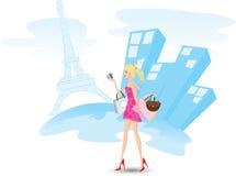 La muchacha está haciendo compras con las tarjetas de crédito en París Foto de archivo