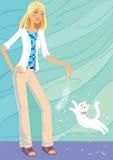 La muchacha está jugando con su pequeño gatito. Imagen de archivo libre de regalías