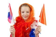 La muchacha está presentando en equipo anaranjado Imagen de archivo