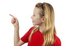 La muchacha está señalando Foto de archivo