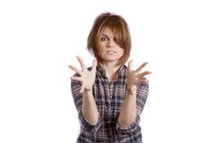 La muchacha expresa gestos de las emociones y a un imitador Imágenes de archivo libres de regalías