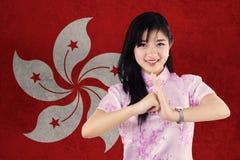La muchacha felicita Año Nuevo chino Fotografía de archivo