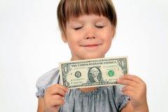 La muchacha feliz con el dólar en manos Imagen de archivo libre de regalías