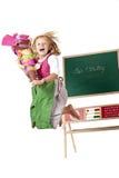 La muchacha feliz en el primer día escolar salta en el aire Imágenes de archivo libres de regalías