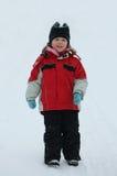 La muchacha feliz en nieve Foto de archivo libre de regalías