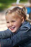 La muchacha feliz está jugando Imágenes de archivo libres de regalías