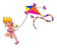La muchacha feliz está jugando con la cometa Imagen de archivo