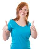 La muchacha feliz manosea el upDescription con los dedos: Chica joven feliz Imagen de archivo