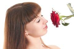 La muchacha goza de un olor de se levantó Fotos de archivo libres de regalías